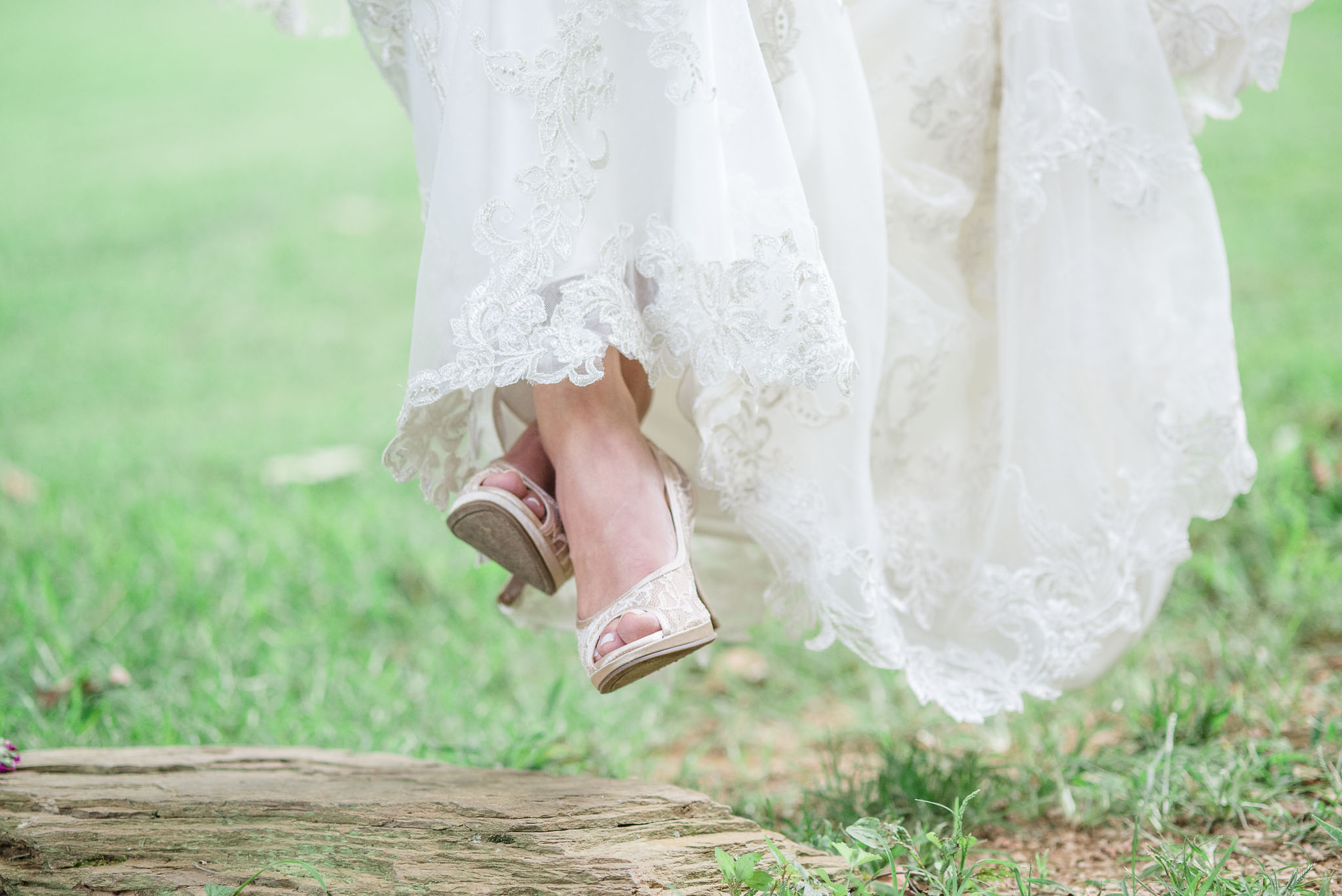 bride in lace wedding dress and shoes