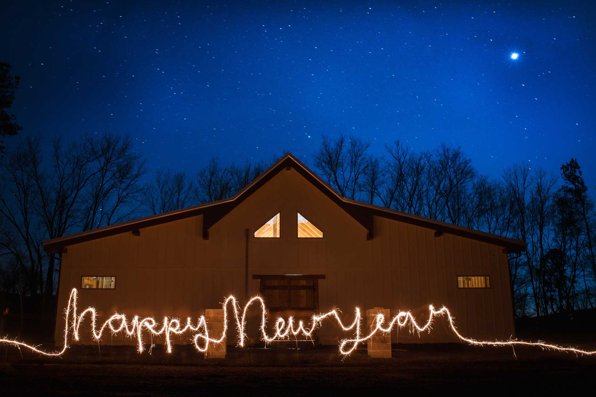 sparkler writing in front of Hiwassee River Weddings in Delano TN